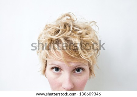 Close-up Blond Girl Head Looking at the camera - Curly Hair - stock photo