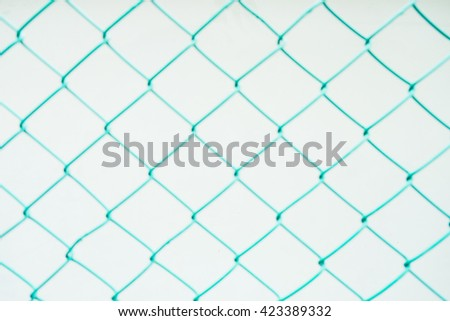 Close up, Blur green steel net on white background. - stock photo