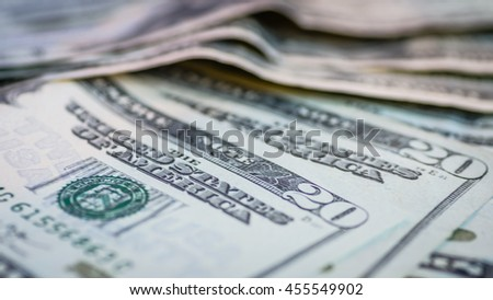 Close up blur image of dollar banknotes background/textures.