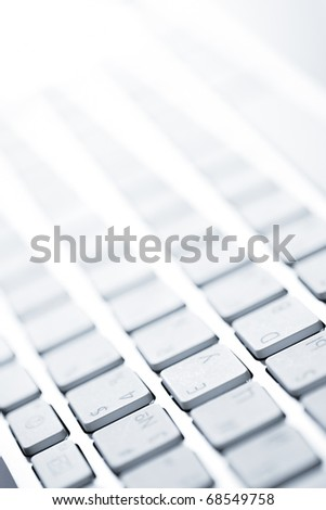 close up blurred view of male hand touching computer keyboard - stock photo