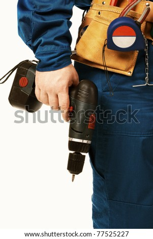 Close up body work man in work wear with instrument and drill against white - stock photo