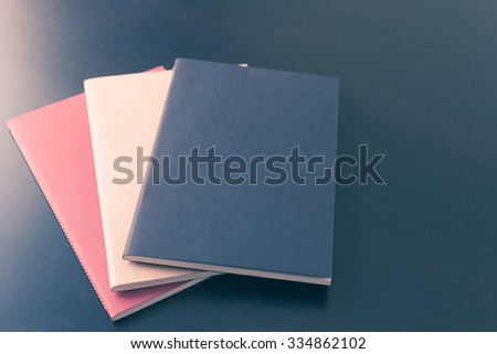 Close up book on black wooden table background - stock photo