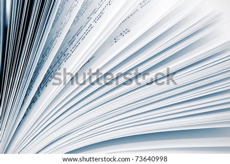 Close up book pages background. Blue toning - stock photo