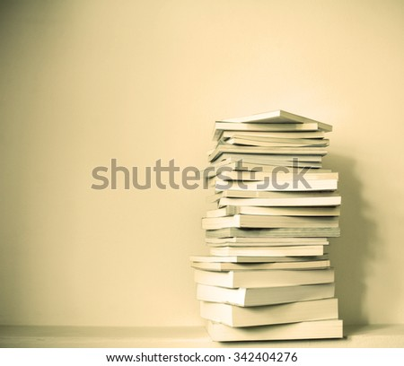 Close up book stacked  with the  concrete wall background - stock photo