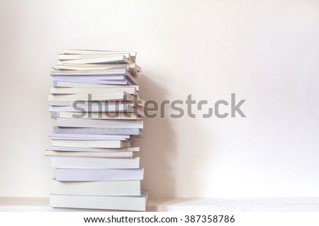 Close up book stacked  with the  concrete wall background