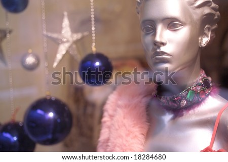 close up Boutique display window with mannequins - stock photo