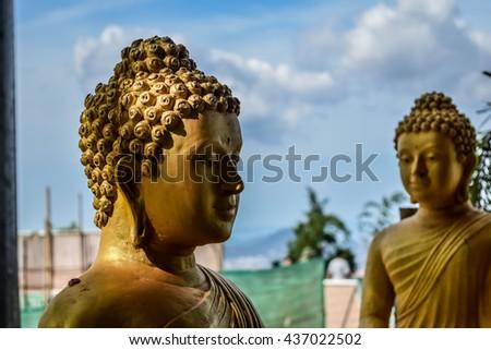 Close up brass statue of buddha. Thailand - stock photo