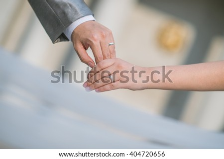 close up bride groom holding hand with sunset (selective focus)