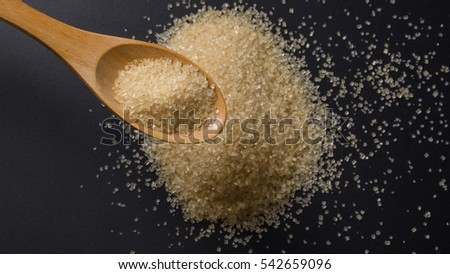 Close up brown sugar in wooden spoon