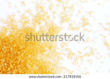 close up brown sugar  on white paper - stock photo