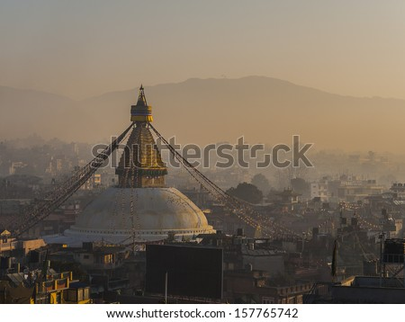 Close-up Buddhist shrine Boudhanath Stupa with Buddha wisdom eyes and praying flags in Kathmandu, Nepal - stock photo