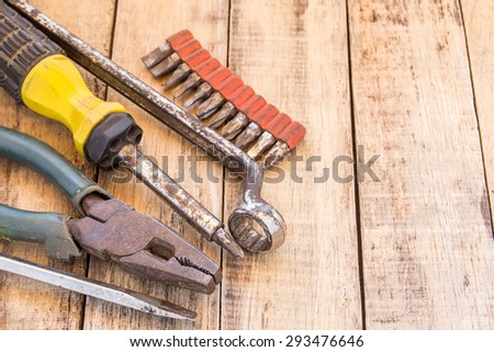 Close up bunch of used tools on wooden table background - stock photo
