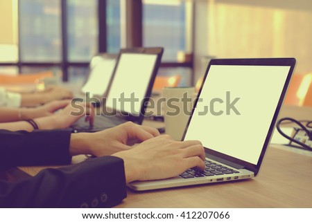 close up business call center employee hand checking or proofing data information at laptop company:worker people:busy office time concept:work hard:research and development:organize management system - stock photo