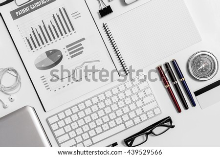 Close up business equipment flat lay mockup on white desk layouts of row working object and technology. - stock photo