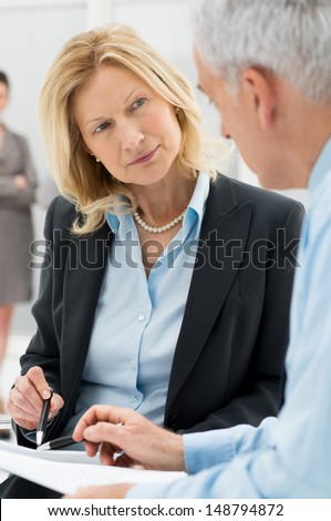 Close Up Business People Discussing Working Together In Office - stock photo