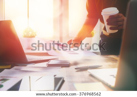 Close up business woman signing documents. - stock photo