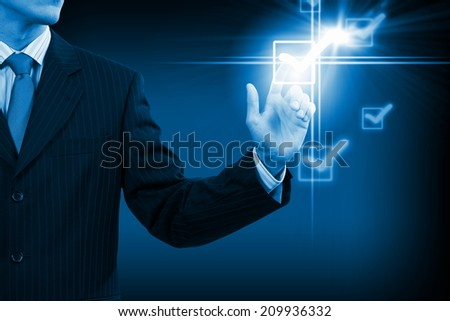 Close up businessman touching ticking icon of media screen - stock photo