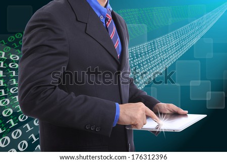 Close up businessman use touch pad for do something - stock photo