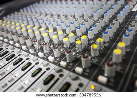 Close up buttons control sound mixer - stock photo