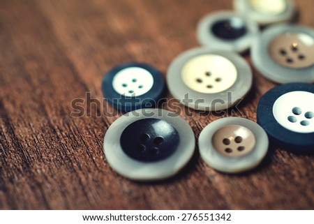 close up, buttons on wood floor background.