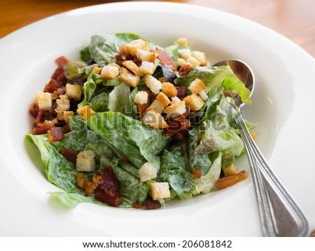 Close up caesar salad in white bowl - stock photo