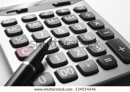 close up calculator with pen on white paper - stock photo