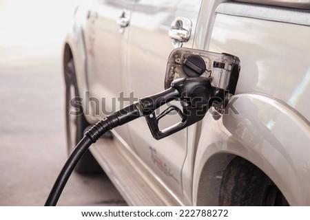 Close up car refuel - stock photo