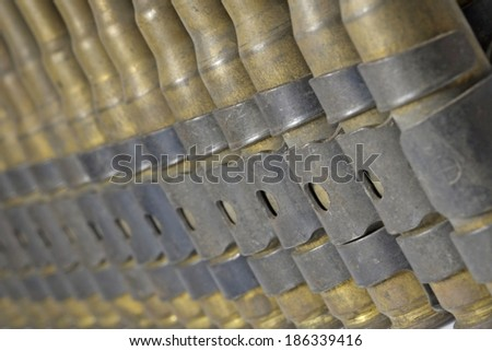 Close up chain of cartridges, used. - stock photo