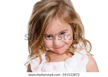 Close up Charming Blond Little Girl Smiling to You Shyly Against White Background. - stock photo