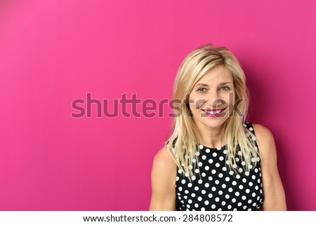 Close up Cheerful Blond Adult Woman Against Pink Background with Copy Space, Smiling at the Camera. - stock photo