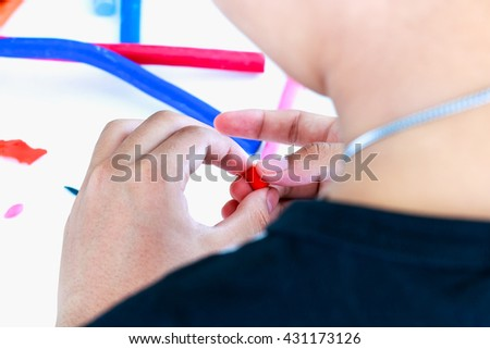 Close up. Child playing and creating toys from play dough. Child molding model clay. Strengthen the imagination of child. Selective focus. - stock photo