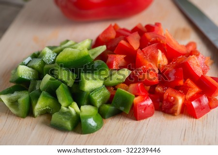 Close up. Chopped green bell pepper and red bell pepper. - stock photo