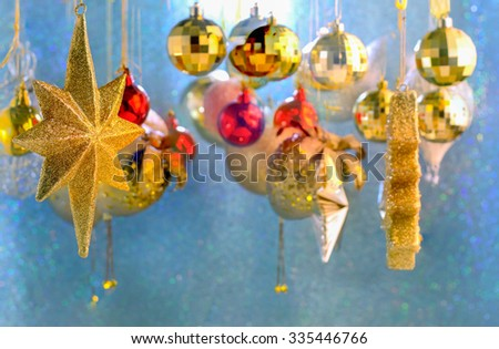 close up Christmas scene with tree gifts and fire in background - stock photo