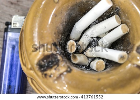 Close up cigarette butts stuck in ash, stop smoking and smoking addiction concept - stock photo