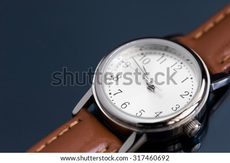 Close up classic lady leather watches on black background. - stock photo