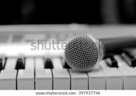 Close-up classical microphone on electronic keyboard  - stock photo