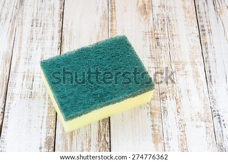 Close up cleaning sponges on wooden background - stock photo