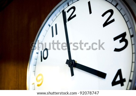 close up clock on wall at time four o'clock - stock photo