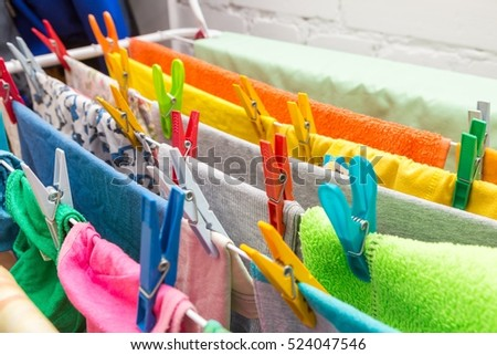 Close up clothes dryer and plastic clips. House clothes drying equipment.
