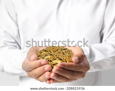 close up coins in his hands - stock photo