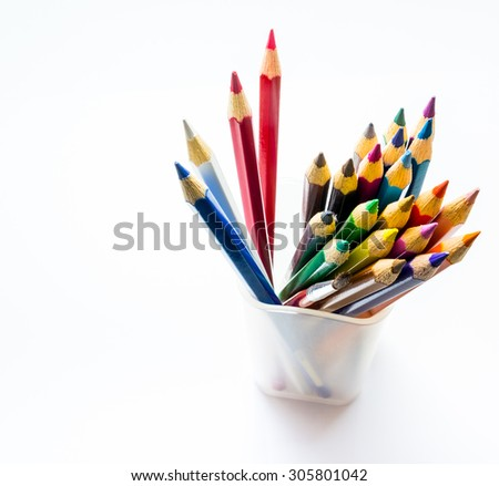 Close-Up color pencils in a plastic glass  on white background - stock photo