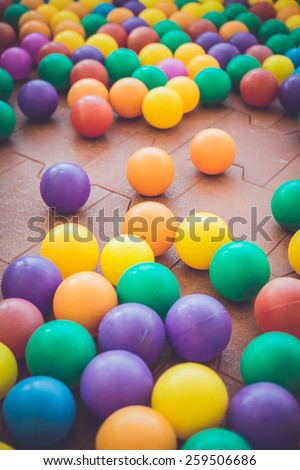 Close up Colorful plastic ball in playground - stock photo