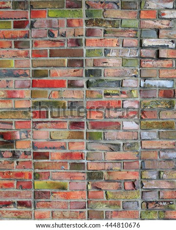 close-up colorful red brickwall finish of external wall - stock photo
