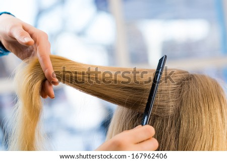 close up combing hair at the hairdresser - stock photo