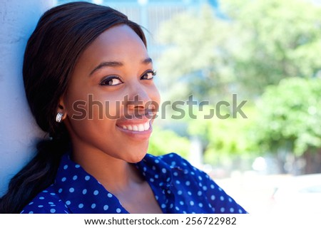 Close up confident young black business woman smiling outdoors - stock photo