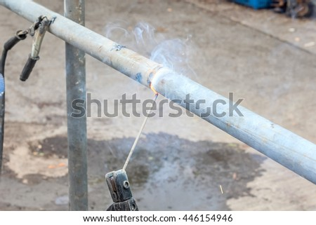 close up construction worker using butt-welding a pipe