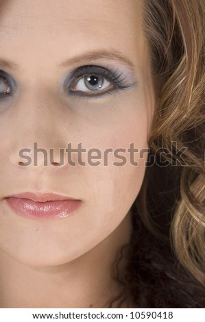 Close up cosmetic portrait of a beautiful  young woman with open eyes - stock photo