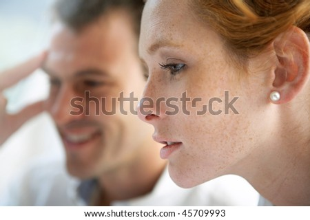 close-up couple working - stock photo