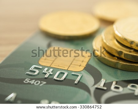 close-up credit card with golden coins in background. selective focus. finance and personal loan concept. - stock photo