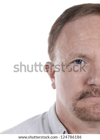 Close-up cropped image of a face of an old man isolated against the white background - stock photo